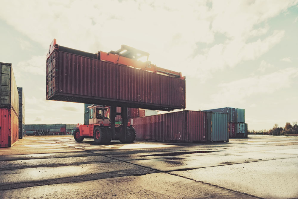 Shipping containers being moved by a truck